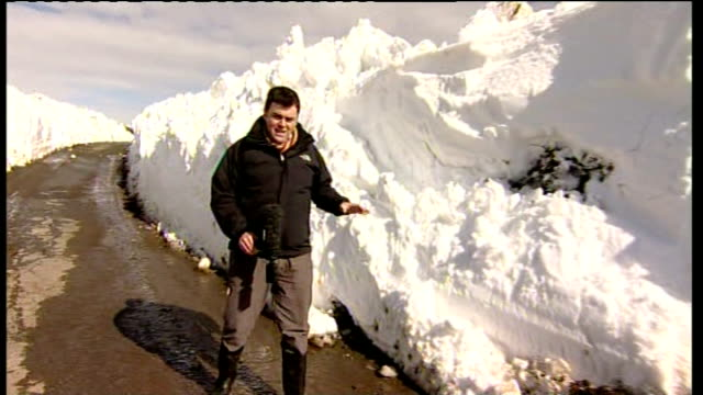 disruption in scotland scotland dumfries and galloway dundrennan ext reporter to camera next to huge snowdrifts / duncan wallace interview sot - dumfries and galloway stock videos & royalty-free footage