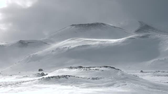 Snow drifts move across a hillside at the Snaefellsnes peninsula.