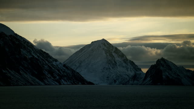 Snow Dusted Coastal Mountain In Canadian Arctic