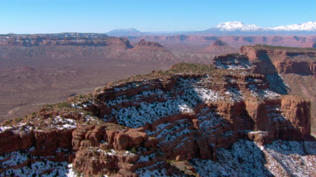 snow dusts canyon walls in canyonlands national park. - canyonlands national park stock videos & royalty-free footage