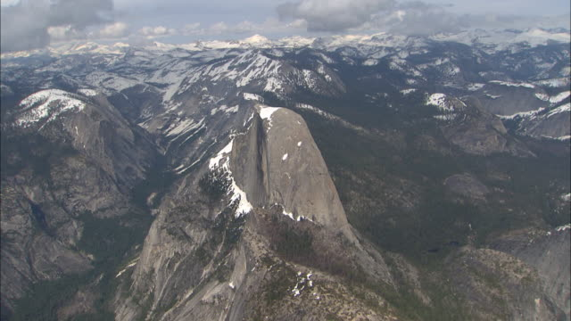 snow dusts half dome, yosemite valley and the surrounding mountains of yosemite national park, california. - half dome stock videos & royalty-free footage