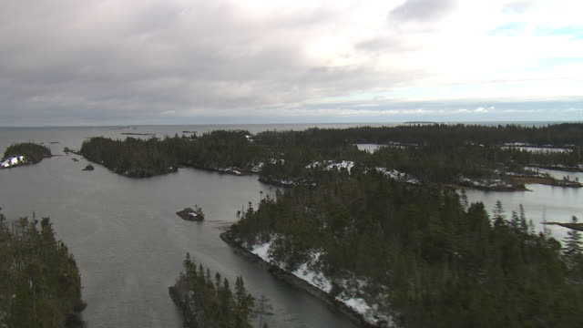 snow dusts small, forested islands in nova scotia. - nova scotia stock videos and b-roll footage