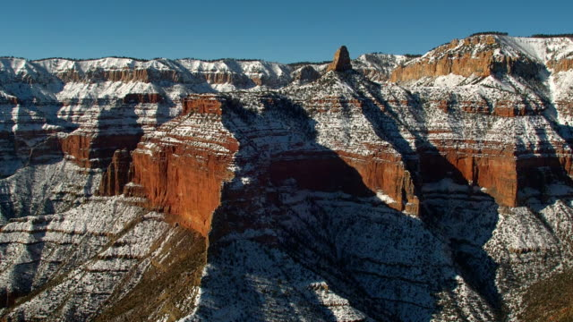 snow dusts the cliffs of the grand canyon. - grand canyon stock-videos und b-roll-filmmaterial