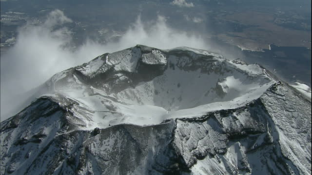 snow dusts the crater and summit of mt. fuji. - mt fuji stock videos & royalty-free footage