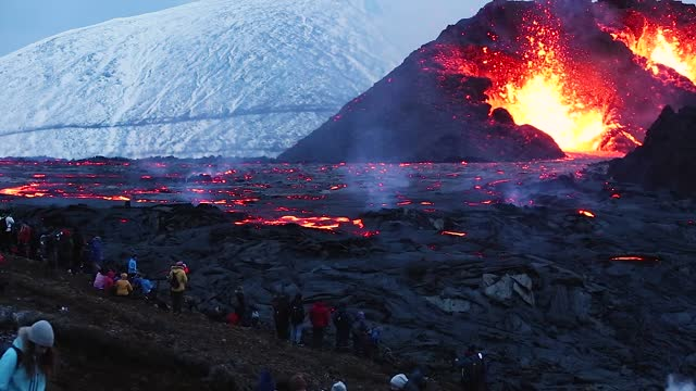 snow dusts the hillside while spectators gather to watch the volcano erupt as the sun sets on march 28, 2021 on the reykjanes peninsula, iceland. the... - iceland stock videos & royalty-free footage