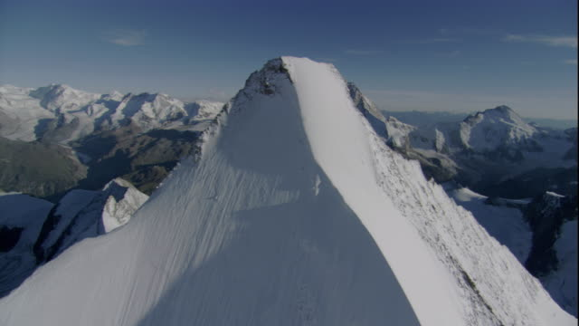 Snow dusts the Matterhorn and other summits of the Swiss Alps. Available in HD.