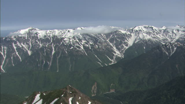 Snow dusts the uppermost peaks of the Hodaka Range in Japan.