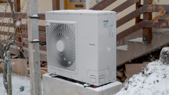 ms snow falling around heat pump outside house - heat stock videos & royalty-free footage