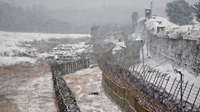 Snow falling on military fence along the DMZ (Demilitarized Zone between South and North Korea), Goseong-gun