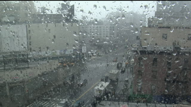 HA WS Snow falling outside window with view of busy street in Tribeca / Manhattan, New York, USA