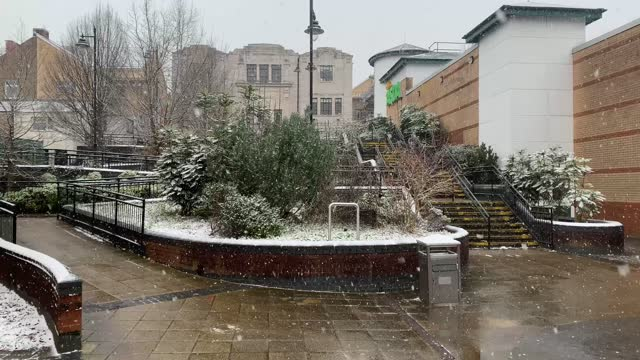 snow falls at a pedestrian precinct on january 31, 2021 in blackwood, wales, united kingdom. the met office have issued a yellow weather warning for... - weather stock videos & royalty-free footage