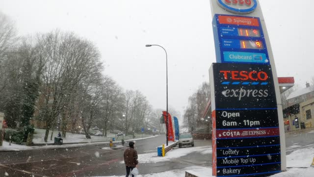 snow falls at a tesco express in forest hill in winter weather conditions on january 24, 2021 in london, united kingdom. parts of the country saw... - snow stock videos & royalty-free footage