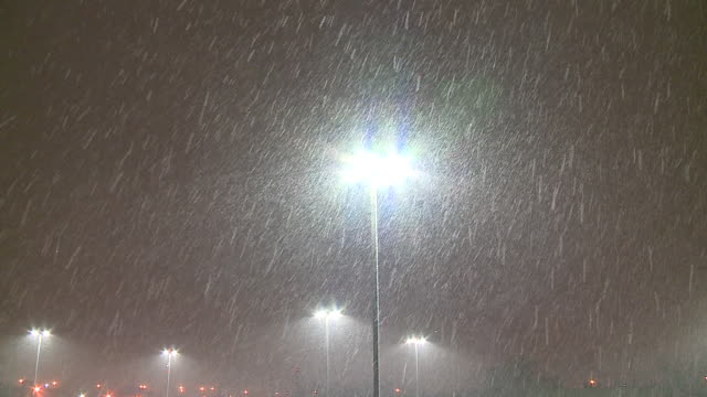 WGN Snow Falls From Night Sky in Front of Parking Lot Lights in Chicago on Dec 11 2017