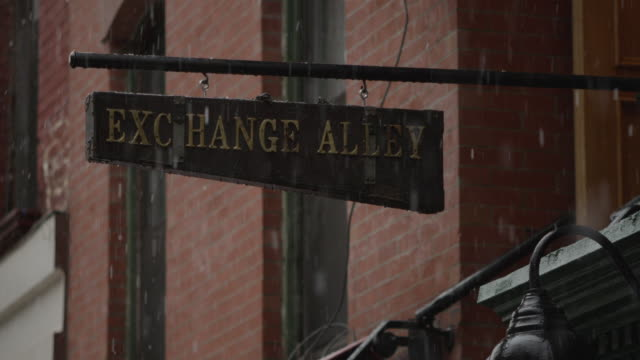snow falls in front of sign in east village, manhattan - western script stock videos & royalty-free footage
