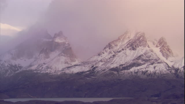 snow falls on mountain peaks in the chilean andes. available in hd. - blizzard stock videos & royalty-free footage