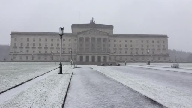 Snow falls on the Stormont estate in Belfast Northern Ireland The Met Office has issued amber 'be prepared' warnings of snow and ice for southern...