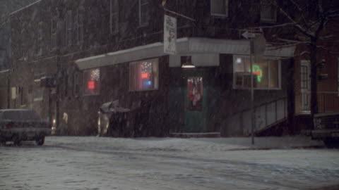 snow falls outside an irish pub in philadelphia. - philadelphia pennsylvania stock videos & royalty-free footage