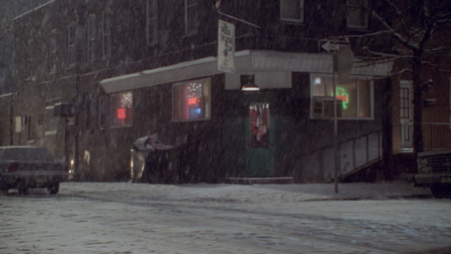 snow falls outside an irish pub in philadelphia. - philadelphia pennsylvania stock videos & royalty-free footage