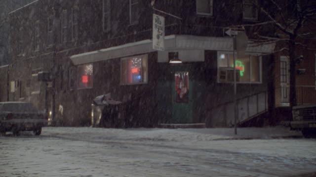 snow falls outside an irish pub in philadelphia. - pennsylvania stock videos & royalty-free footage