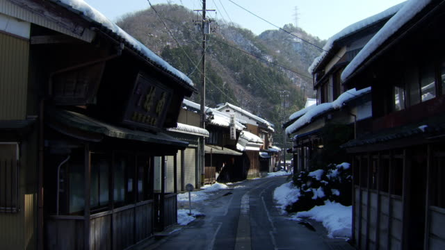 snow filled town of imajo, fukui, japan - 村点の映像素材/bロール