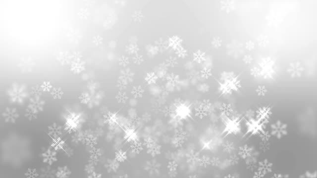snow flakes falling with sparking light on blue background, christmas background - greeting card stock videos & royalty-free footage