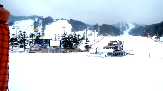 Snow groomer machines for skiing slope preparations