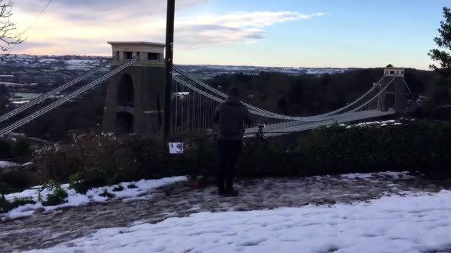 snow has fallen on the clifton suspension bridge and observatory in bristol motorists have been warned of dangerous conditions on the roads and air... - clifton suspension bridge stock videos and b-roll footage