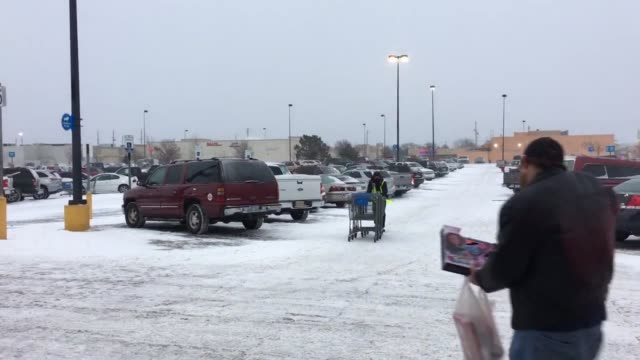 snow hits wichita kansas just in time for the holidays - wichita stock-videos und b-roll-filmmaterial