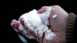 snow in man hands