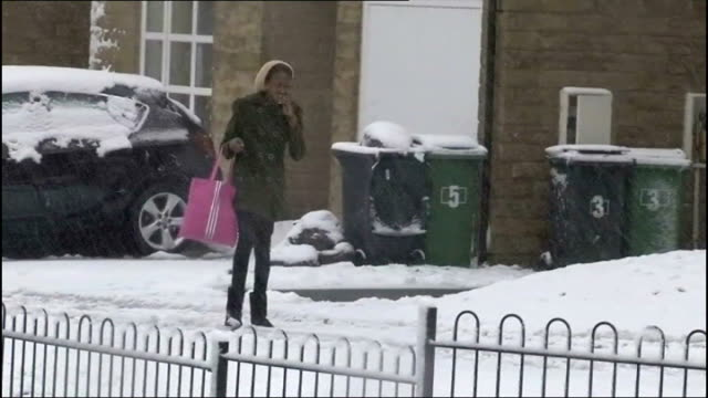 power cuts woman along snow covered suburban street disposable barbecue covered with snow - disposable stock videos and b-roll footage