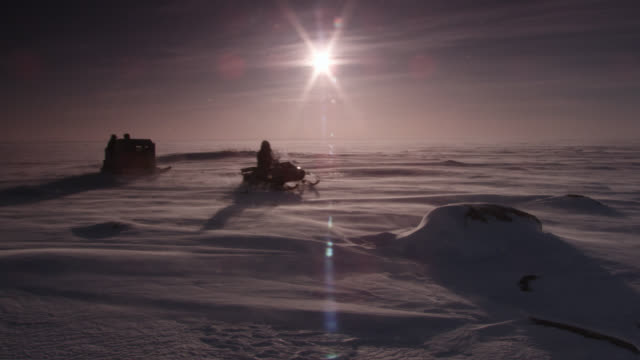 snow mobile with sled crosses tundra, canada - arctic stock videos & royalty-free footage