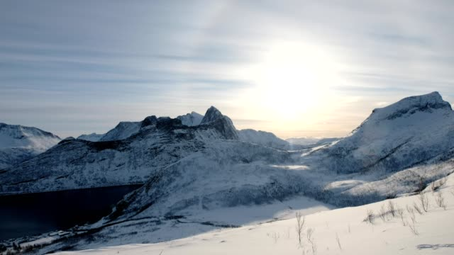 snow mountain range on peak with sun halo at segla island, norway - northern europe stock videos & royalty-free footage