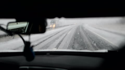 snow on the highway.dangerous driving - articulated lorry stock videos & royalty-free footage