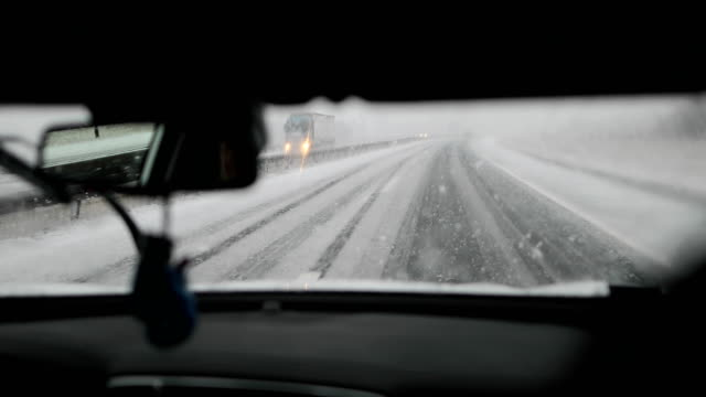 snow on the highway.dangerous driving - snow storm stock videos and b-roll footage