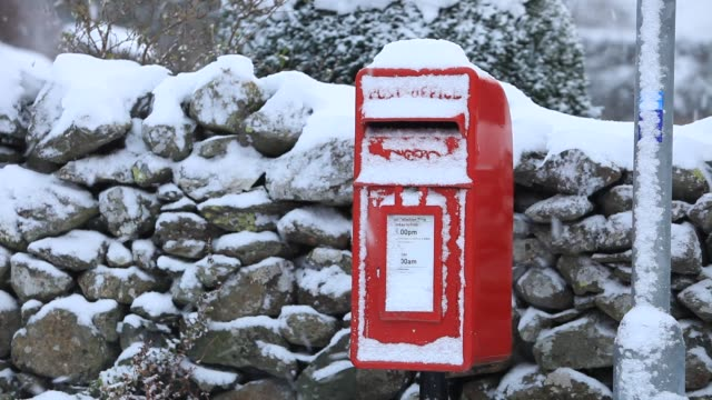 snow over a post box in thirlmere in the lake district uk. - letterbox stock videos & royalty-free footage