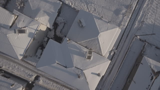 Snow over roofs raw