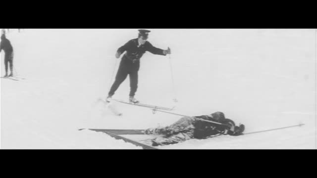snow patrol skiers in colorful anoraks police officers skiing to incidents injured person carrying with snowboat boredlooking policeman day's... - joshinetsu kogen national park stock videos and b-roll footage