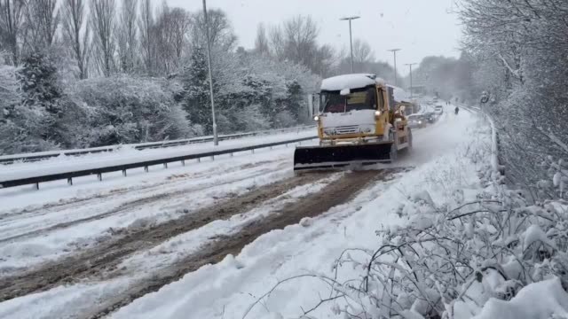 vídeos y material grabado en eventos de stock de a snow plough works to clear the a11 newmarket road at norwich where cars are stuck due to the severe weather conditions - quitanieves
