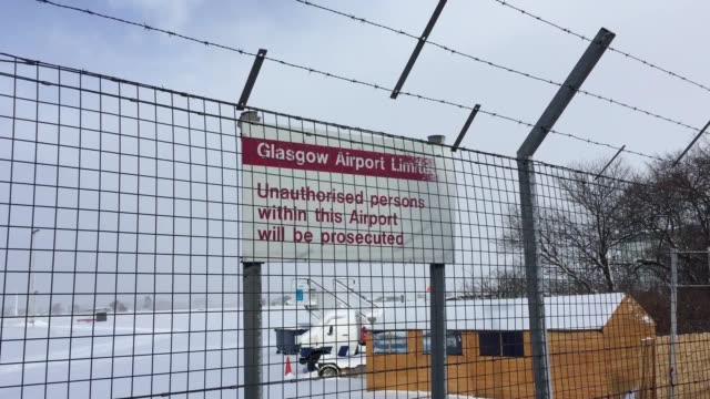 snow ploughs try to clear the runway at glasgow airport which has been closed amid amber weather warnings - glasgow international airport stock videos & royalty-free footage