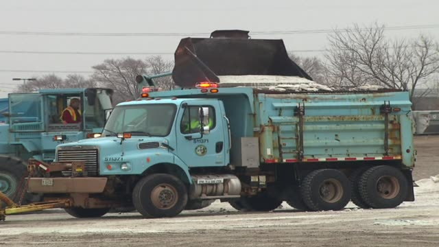 snow plow trucks with salt on january 14 2012 in chicago illinois - fanghiglia video stock e b–roll