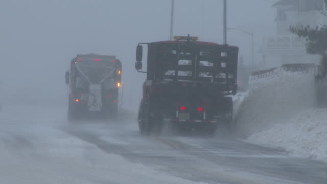 Snow plows clear the road of deep snow along Ocean Avenue in Belmar NJ during the height of the Blizzard of 2016