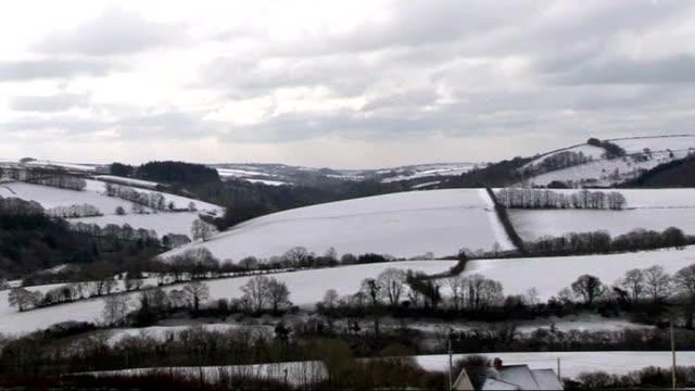 snow scenes on exmoor and dartmoor; england: devon / somerset: exmoor ext / snow range rover car along snow-covered road through exmoor/ exmoor... - dark stock videos & royalty-free footage