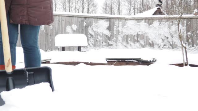 snow shoveling - leg warmers stock videos & royalty-free footage
