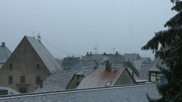 Snow shower in a little french village