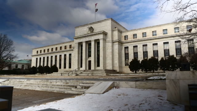 snow sits on the ground in front of the marriner s eccles federal reserve in washington dc us exterior shots of the main entrance to the marriner s... - us finanzministerium stock-videos und b-roll-filmmaterial
