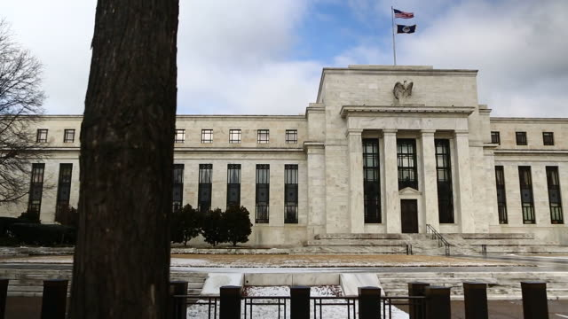 snow sits on the ground in front of the marriner s eccles federal reserve in washington dc us exterior shots of the main entrance to the marriner s... - finanzministerium stock-videos und b-roll-filmmaterial