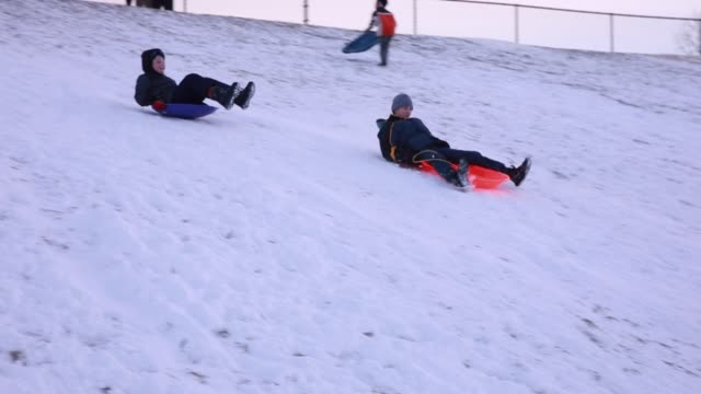 Snow sledders take adavantage of the first winter snow worthy of snowsledding at TriNorth Middle School in Sunday January 20 2019 in Bloomington...