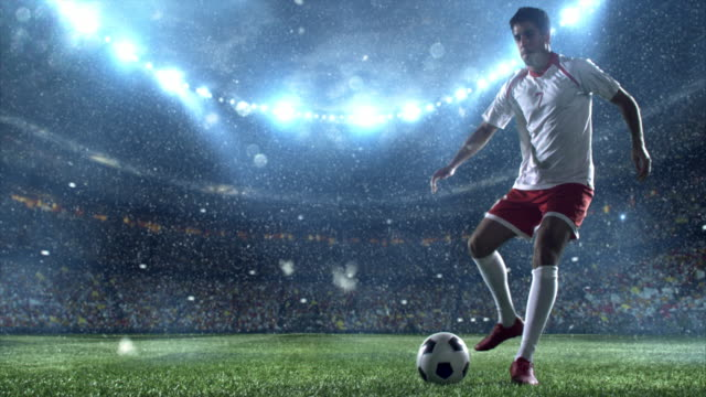 snow: soccer player makes a dribbling - major league soccer stock videos and b-roll footage