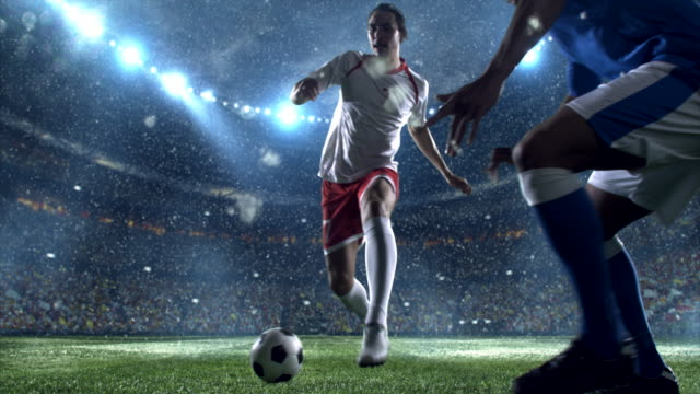 snow: soccer player makes a dribbling - dribbling stock videos & royalty-free footage