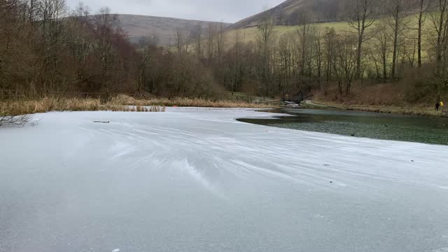 snow starts to gather and blow on a partially frozen lake on february 13 at abertillery wales, united kingdom. the met office has issued a yellow... - non urban scene stock videos & royalty-free footage